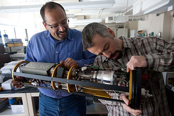 Peter Girguis (left), John L. Loeb Associate Professor of the Natural Sciences, and research scientist Scott Wankel work with an underwater mass spectrometer for analyzing gases.