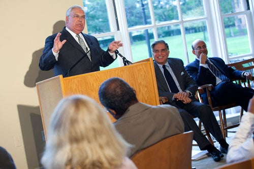 "Boston Mayor Thomas M. Menino (standing at podium) joined Harvard in announcing the University's first lab for innovation and entrepreneurship, which will open in fall 2011 in Allston. Harvard Business School (HBS) also announced a $50 million gift from Ratan Tata (center), the chairman of Tata Sons Ltd, which will support a new executive education building. ""Our goal is to drive innovation by connecting entrepreneurial teams, not only across the Charles River, but nationally and internationally, in an interdisciplinary approach to creating viable business ventures and social initiatives,"" said HBS Dean Nitin Nohria (right). Stephanie Mitchell/Harvard Staff Photographer"