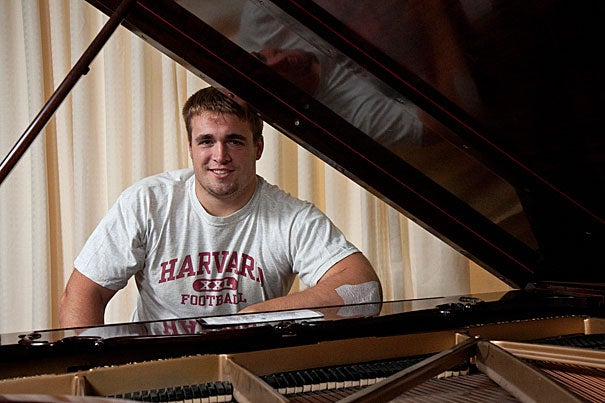 Despite weighing in at a hefty 280 pounds, Chris LeRoy '11, starting center on the Harvard football team, has a delicate touch when he's playing the music of Billy Joel or Ray Charles on the piano. Jon Chase/Harvard Staff photographer