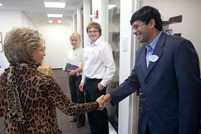 Since its founding more than 20 years ago, the Edmond J. Safra Center for Ethics' fellowship programs have hosted more than 250 scholars. Lily Safra meets fellows Prithviraj Datta (far right), Nicholas Cornell, and Maria Banda, during a visit to the center on Tuesday (Oct. 19).