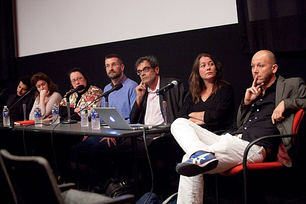 Artists Wael Shawky (from left), Lamia Joreige, Peggy Ahwesh, William E. Jones, Harun Farocki, moderator Antje Ehmann, and Kota Ezawa participate in a panel discussion on the question of how wars of the present and the experience of war can be adequately represented.