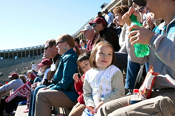 Emily Wang of Cambridge enjoys a beautiful day in Harvard Stadium during Cambridge Family Football Day.