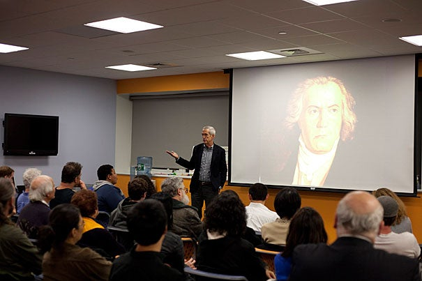 "Thomas Kelly, Harvard's Morton B. Knafel Professor of Music, addressed a crowd at the Harvard Allston Education Portal. Kelly's talk was based on his popular course ""First Nights,"" where he explores the performance premieres of five seminal music works through a cultural, musical, and historical lens."