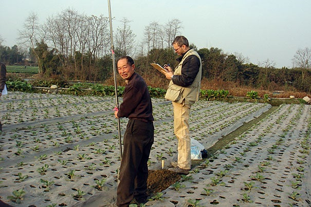 Associate Professor of Anthropological Archaeology Rowan Flad (right) conducts an auger survey during the 2009-10 season. Survey techniques commonly used by archaeologists aren't useful in the Chengdu Plain because surface materials are obscured by the ongoing agricultural uses of the land. Team members must drill 2-meter-deep survey holes at regular intervals with hand augers.