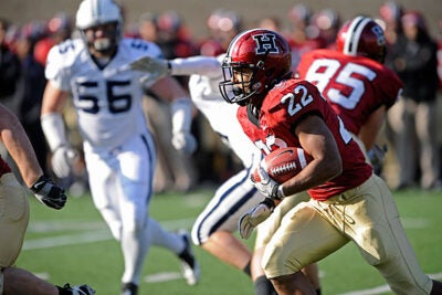 Gino Gordon '11 moves the ball past Yale as the Crimson beat the Bulldogs with a 28-21 win.