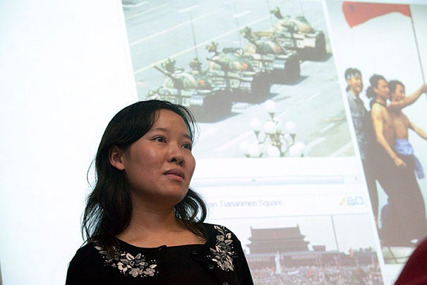 """Twenty-one years ago, when Rowena He wore a black armband as a gesture of mourning on the day after the Tiananmen Square violence, she recalls being told, """"If you don't take that off, no one will protect you."""" Now she is teaching a freshman seminar, """"Rebels With a Cause: Tiananmen in History and Memory,"""" that tackles the infamous Chinese protests."""