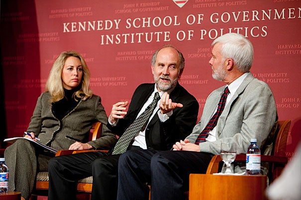 """Graham Allison, who directs the Belfer Center, moderated a Harvard Kennedy School Forum panel on the future of nuclear weapons. The gist: There is real reason to fear because, given that there are thousands of bombs, global terrorists could exploit a security gap. """"All we're talking about is just one,"""" said Rolf Mowatt-Larssen (far right), a senior fellow at the Belfer Center who worked for the Central Intelligence Agency for 23 years. """"We've got to be right all the time [about security]. The terrorists only have to be right once for us to fail."""" Other panelists included former CIA agent Valerie Plame Wilson (left) and Matthew Bunn (center), a co-principal investigator for the Harvard Kennedy School's Project on Managing the Atom Scholars."""