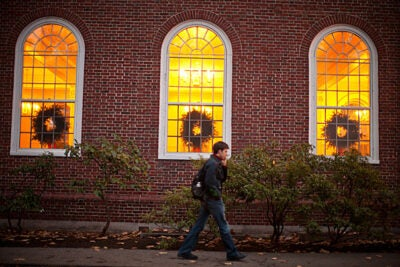 Can't be late to the party! Rob Schaaf makes his way to dinner at Kirkland House, decorated for the season.