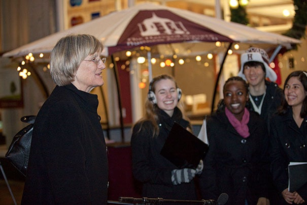 Dozens of staff, faculty, and students — along with local business owners and President Drew Faust (left) — turned out at Forbes Plaza to kick off Crimson Shops Local, an annual effort by the University and the Harvard Square Business Association to encourage shopping nearby for the holidays. Among the performers, Harvard's LowKeys (right).