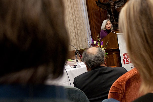 "Harvard Law School Dean Martha Minow (at podium) said she set out to write a book that acknowledged the limitations but celebrated the achievements of the 1954 Supreme Court decision Brown v. Board of Education of Topeka. The result was ""In Brown's Wake: Legacies of America's Educational Landmark,"" which was the cornerstone of a two-panel discussion at Harvard on Dec. 4."
