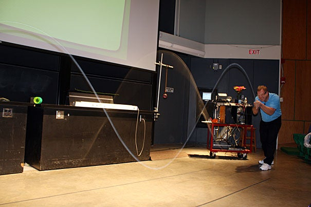 """Guest speaker Howard Stone (right) demonstrates a standing wave during a lecture titled """"Good Vibrations: How We Communicate,"""" which was hosted by Harvard's School of Engineering and Applied Sciences."""