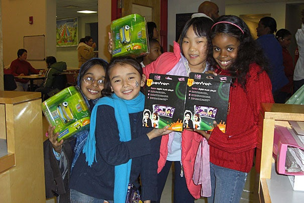 Children from Boston's West End House, which aims to transform the lives of immigrant and urban youth, celebrate at last year's Christmas party. West End House offers its members leadership and life skills, literacy programs, jobs, and more.