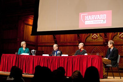 "Harvard on the Move, a new initiative sponsored by President Drew Faust (from left), kicked off with a panel discussion at Sanders Theatre on Wednesday. Panelists included Daniel Lieberman, professor of human evolutionary biology and department chair of human evolutionary biology in the Faculty of Arts and Sciences, Christopher McDougall '85, author of ""Born to Run: A Hidden Tribe, Superathletes, and the Greatest Race the World Has Never Seen,"" and John Ratey, an associate clinical professor of psychiatry at Harvard Medical School."