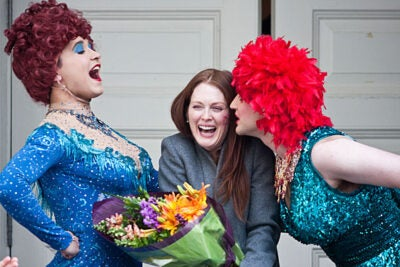 Woman of the Year Julianne Moore, flanked by Hasty Pudding members Michael Barron '11 (right) and Kyle Dancewicz '11, receives a kiss while standing on the New College Theatre steps. An overnight snowstorm prevented the traditional parade down Massachusetts Avenue.
