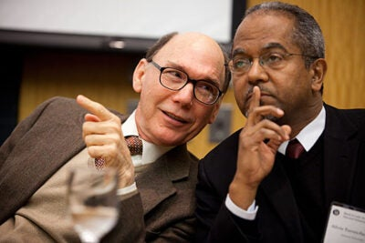 "Perceptions of race are far more nuanced and subtle, if still sometimes insidiously false, in Latin America than in this country. As panel participant Silvio Torres-Saillant (right) put it, ""I didn't know I was black until I came to the United States."" Joining the conference was also Frank Moya Pons (left), a professor of Latin America and a former minister in the Dominican government."