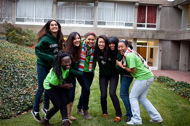 "Men and women dwell in modern-day Currier House, which is the only House named after a female. Resident Nadia Farjood '13 (far left, in green sweatshirt) said, ""It is inspiring walking through the doors of Currier and seeing the faces of five women, all distinguished alumnae of Radcliffe College, to my left. Most wall space at Harvard is devoted to images of men, and I am proud to live in the only House named after a female."""