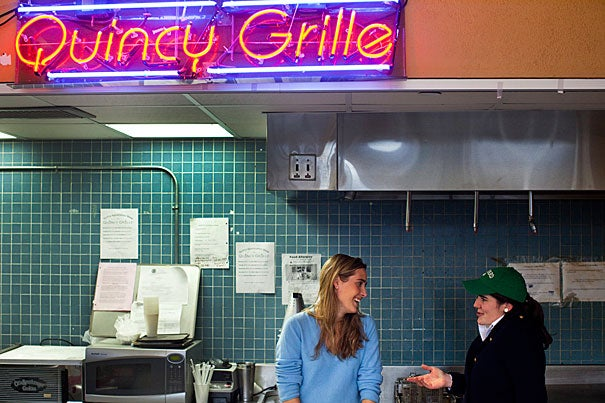 "Schuyler Daum (left) and Kerry Clark manage the Quincy Grille, a late night eatery and social space nestled in Quincy House. Says Clark, ""It's important for Harvard to have places where people can meet that aren't academic and go beyond the dining hall."""