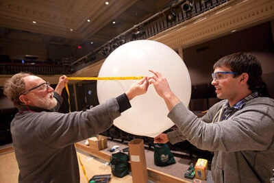 Barry Griffin (left), a visiting lecturer on design and design curriculum development, led a group undergrads on a winter break project to invent and construct a balloon-supported structure that could be used for lifting and/or shelter in the wake of disasters like last year's earthquake in Haiti. Here, the prototypes are built in Lowell Lecture Hall.