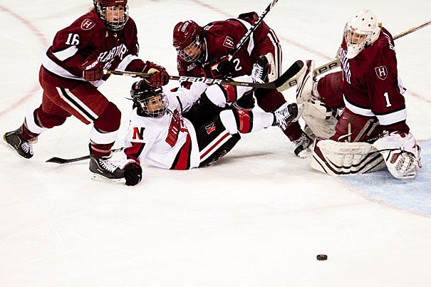 All eyes are on the puck as Northeastern tries to score against the Crimson. Battling it out on the ice are Marissa Gedman (from left), Josephine Pucci, and Laura Bellamy. The Crimson managed to erase a two-goal deficit to force an ultimately scoreless sudden-death overtime, followed by the shootout, beating Northeastern University 4-3.