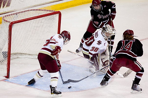 Harvard's Jillian Dempsey (right) nearly scores against Boston College in the Beanpot finals at Conte Forum on Tuesday (Feb. 15). Boston College prevailed 3-1.