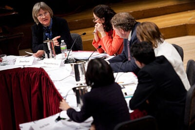 "Ten years after the Human Genome Project completed the human genome's first draft, Harvard President Drew Faust (far left) hosted a panel discussion on the legacy of ""biology's moonshot.""  The panelists included (from left) Margaret Hamburg, Eric Lander, M. Susan Lindee, Vamsi Mootha, and Vicki Sato."