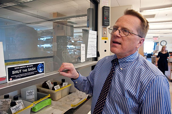 "Allen Hebert, HMS energy specialist, demonstrates the ""Shut the Sash"" in a lab at the New Research Building."