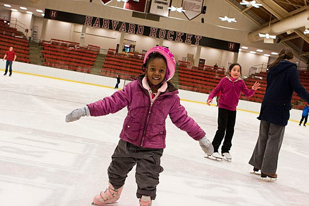 "Last year, Grace Theodore (pictured), now 5, relied on a crate to get around the rink. ""It's her first time skating without the crate so she's really enjoying it,"" said Ermita Theodore as her daughter tried to keep up with her siblings."
