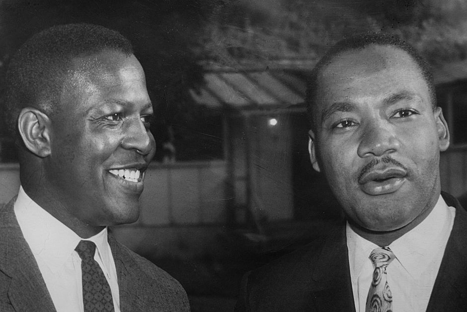 Harvard Graduate School of Education Professor Emeritus Charles Willie (left) speaks with the Rev. Martin Luther King Jr. at Syracuse University. Photo courtesy of Professor Charles Willie