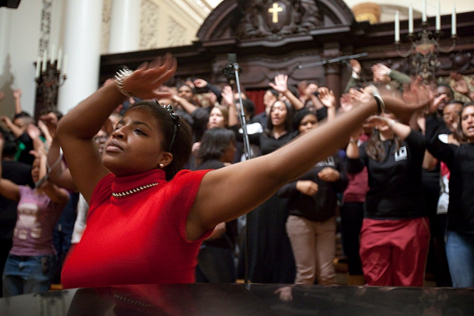 "Dec. 4, 2009. Amber James '11 rehearses for the Kuumba Singers of Harvard College winter concert inside the Memorial Church: ""The songs we sing and the dances we do and the poems we read, they are all designed to bring people together in celebration of black creativity and spirituality. The concert is so moving because of the range of emotions that are represented in music from the black diaspora. Pain, sorrow, strength, resilience, peace, joy, love, and countless others are all intensely felt through the music and movements."" Photo by Kris Snibbe/Harvard Staff Photographer"