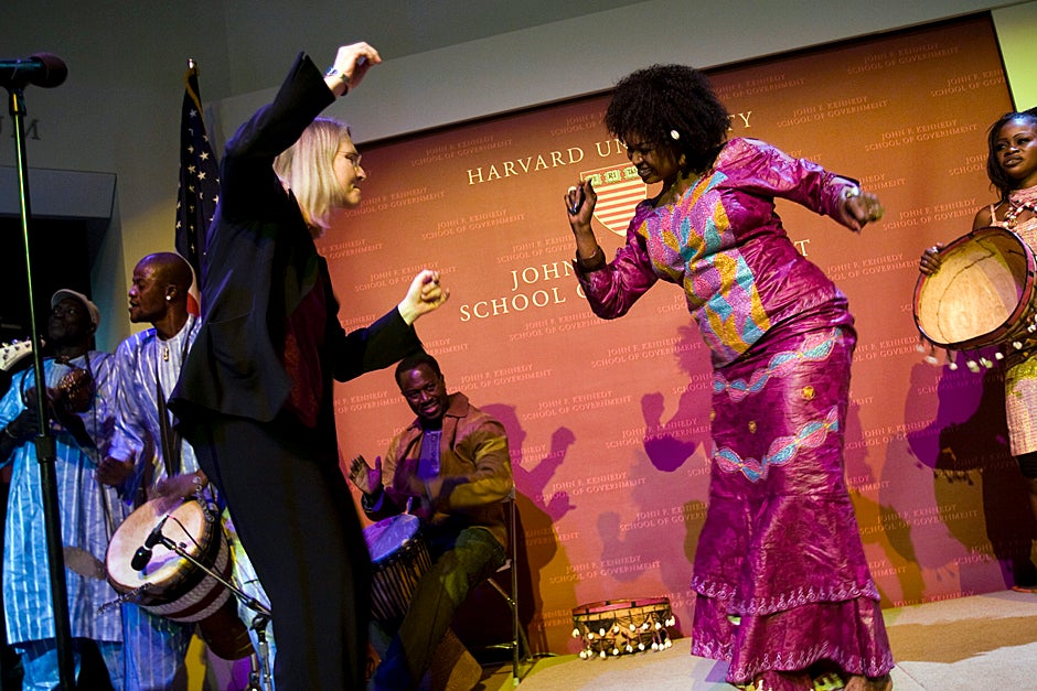 "Dec. 10, 2008. Ingrid Monson (left), Quincy Jones Professor of African-American Music, dances with Oumou Sangare, Mali's great diva and champion of women's rights, during a special performance at the Harvard Kennedy School forum ""Sixty Years of Human Rights."" Photo by Stephanie Mitchell/Harvard Staff Photographer"