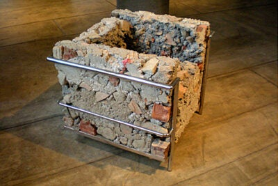 """Los Angeles-based artist Liz Glynn '03, this year's Sert Practitioner, created a witty replica of a Le Corbusier chair — in concrete — on display at the Carpenter Center through Feb. 20. It's called """"On the Museum's Ruin (Morris Hunt – Corbusier – Piano),"""" 2011."""