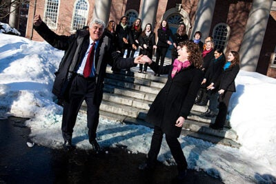 Hasty Pudding Man of the Year Jay Leno pulls lead vocalist Marit Medefind '12 into a dance during a serenade by the Radcliffe Pitches.