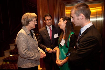 Harvard President Drew Faust (from left) talks with Rodrigo Ravilet, M.B.A. '03, Diana Huidobro, 2006 Extension School alum, and Matias Rivera, Harvard College alum, during a reception before the Harvard Club of Chile Dinner in Santiago, Chile. Photo by Kris Snibbe/Harvard Staff Photographer