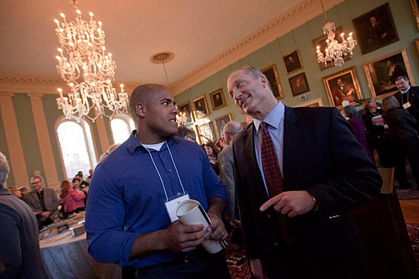 Dean of the Faculty of Arts and Sciences Michael D. Smith (right) hosted the second annual Dean's Distinction award ceremony honoring exceptional FAS employees such as James Frazier, director of strength and conditioning for Harvard Athletics.