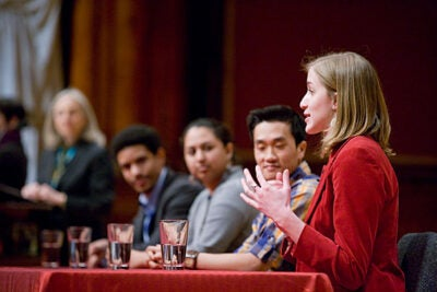 Seniors Romeo Alexander (from left), Tara Venkatraman, Lam Pham, and Amelia Muller discuss their experiences at Harvard at a Sanders Theatre panel during Harvard College Junior Parents Weekend.