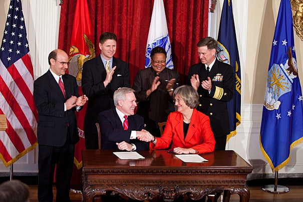 Harvard University will again host a Reserve Officers' Training Corps (ROTC) program on campus. The agreement, signed Friday afternoon at Loeb House by Secretary of the Navy Ray Mabus (left) and President Drew Faust, will end a 40-year hiatus.