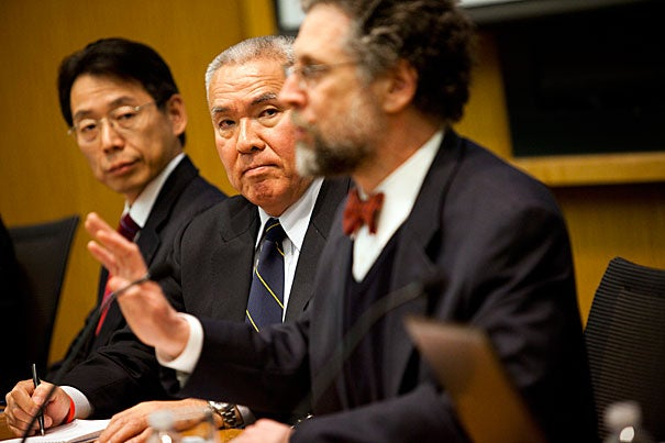 "Takeshi Hikihara (from left), Yoji Koda, and Michael Reich participated in the discussion. ""It's clear we're entering a new stage in how this disaster is evolving in Japan,"" said Reich, the Taro Takemi Professor of International Health Policy."