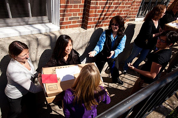 Harvard staff pitched in to help load the mail truck with letters of admission. The letters were mailed out today (March 30) to 2,158 students, 6.2 percent of the record pool of 34,950 applicants. More than 60 percent of the admitted students will receive need-based scholarships averaging more than $40,000, benefiting from a record $160 million in financial aid.