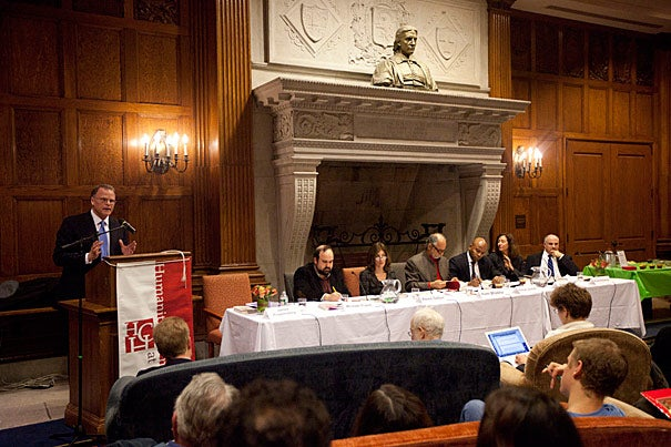 """James Kloppenberg (at podium) fielded questions on his book """"Reading Obama"""" from Michael Frazer (from left), Alexis Gelber, moderator Homi Bhabha, Peniel Joseph, and Elisa New. The panelists pressed Kloppenberg on whether Obama's strengths as a thoughtful political analyst serve him well now that he is faced with hard realities of governing with an unyielding opposition."""