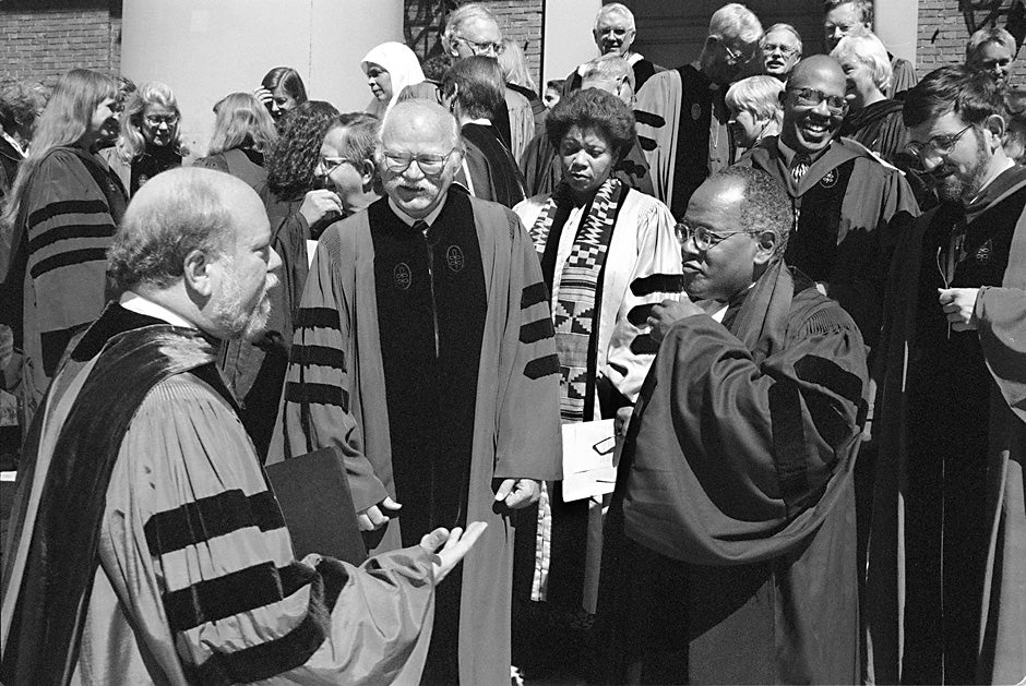 Ronald F. Thiemann (from left), Harvard Divinity School dean and John Lord O'Brian Professor of  Divinity, speaks with Ralph B. Potter Jr., professor of social ethics, and Peter J. Gomes, Plummer Professor of Christian Morals and Pusey Minister in the Memorial Church, at the Divinity School's 181st convocation in 1997. Kris Snibbe/Harvard Staff Photographer