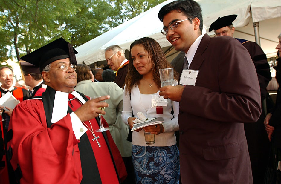 Rev. Peter J. Gomes (from left), Melissa Ann Eccleton, and Rohit Chopra chat during a party at Loeb House following the inauguration of Lawrence H. Summers as Harvard University president in 2001. Stephanie Mitchell/Harvard Staff Photographer