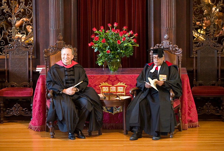 Harvard President Lawrence Summers (left) and the Rev. Peter J. Gomes lead the Baccalaureate Service for seniors and their families in Memorial Church in 2006. Stephanie Mitchell/Harvard Staff Photographer