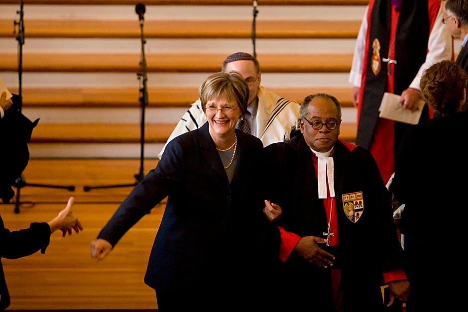 Drew Faust (left) is escorted by Rev. Peter J. Gomes, the Plummer Professor of Christian Morals and Pusey Minister in the Memorial Church, during her installation as the 28th president of Harvard University in 2007. Ceremonies began with a service of thanksgiving at Memorial Church. Rose Lincoln/Harvard Staff Photographer