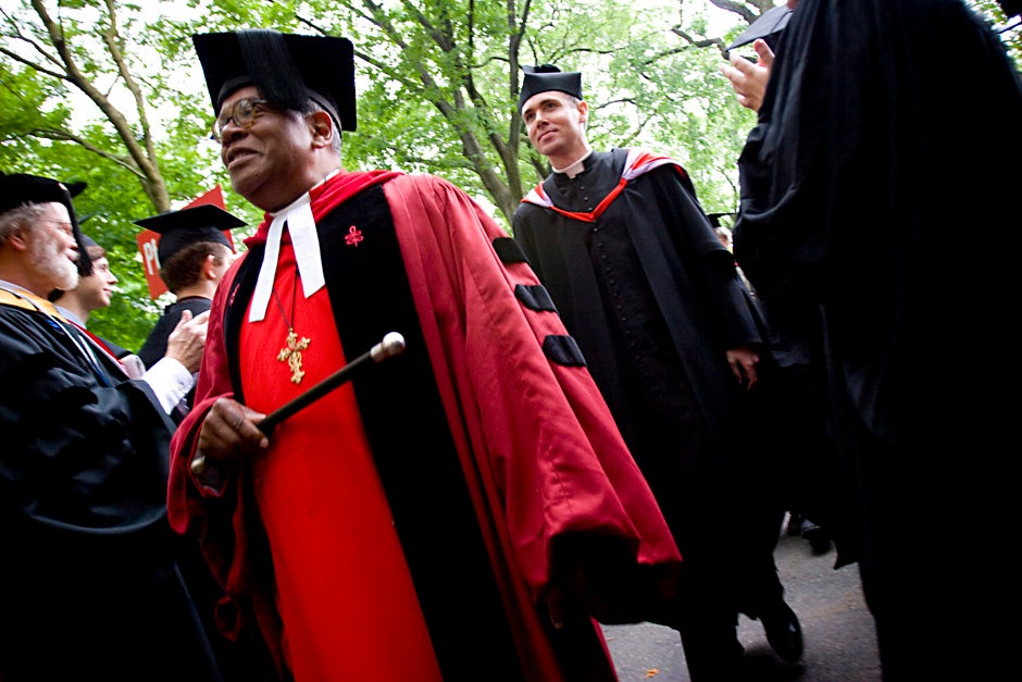 Rev. Peter J. Gomes walks down the aisle of graduates at Harvard's 357th Commencement in 2008. Stephanie Mitchell/Harvard Staff Photographer