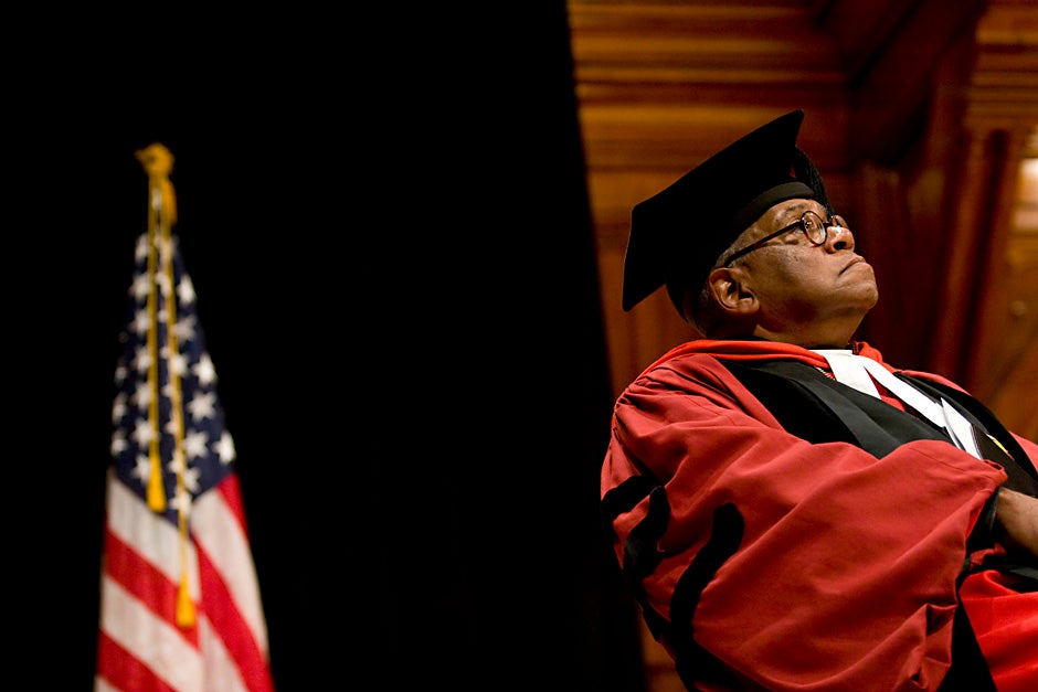 Rev. Peter J. Gomes attends a ceremony in Sanders Theatre honoring Massachusetts Sen. Edward M. Kennedy with an honorary degree in December 2008. Stephanie Mitchell/Harvard Staff Photographer