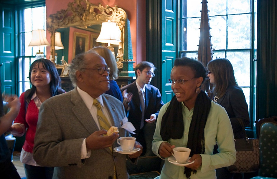 September 2009. Rev. Peter J. Gomes (from left), Plummer Professor of Christian Morals and Pusey Minister in the Memorial Church, speaks with Harvard Divinity School student Shaundra Cunningham while hosting Wednesday Tea, a weekly tradition during term inside Sparks House at Harvard University. Kris Snibbe/Harvard Staff Photographer