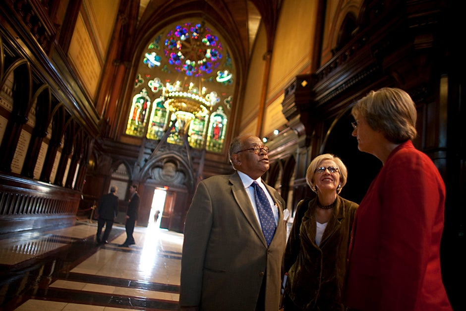 """Harvard President Drew Faust (right) speaks with the Rev. Peter J. Gomes and Professor Dorothy Austin in the transept of Memorial Hall after giving a """"State of the University"""" address in September 2009. Justin Ide/Harvard Staff Photographer"""