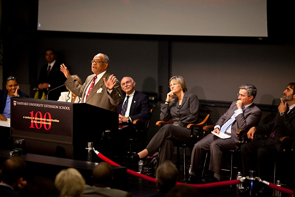 Rev. Peter J. Gomes, Plummer Professor of Christian Morals and Pusey Minister in the Memorial Church, concludes a centennial convocation event at Harvard Extension School in September 2009. Harvard Extension School Dean Michael Shinagel (seated behind Gomes), Harvard President  Drew Faust, and President of Colombia Álvaro Uribe Vélez listen. Justin Ide/Harvard Staff Photographer