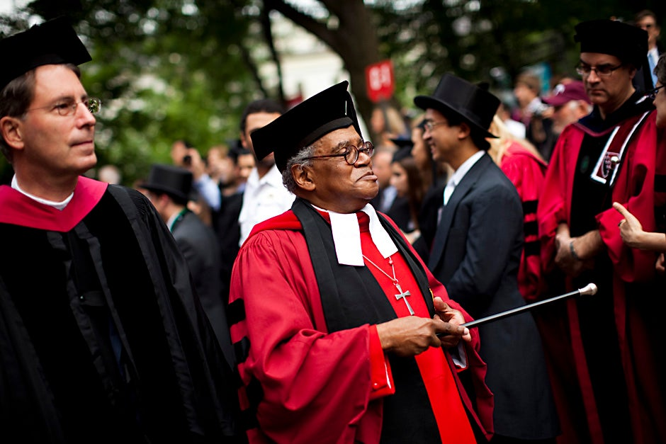 Rev. Peter J. Gomes processes past Widener Library during Commencement Morning Exercises at Harvard in May 2010. Stephanie Mitchell/Harvard Staff Photographer