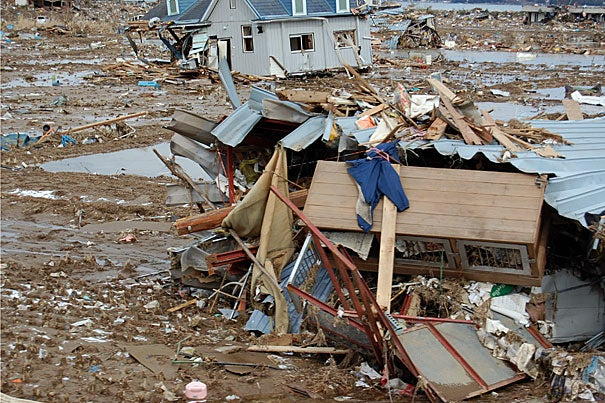 Mud, trash, and wrecked houses were swept a mile inland by the tsunami that struck Kesennuma and a swath of coastal Japan. Nearby, a Buddhist temple stood untouched. It was on land a mere foot higher in elevation.